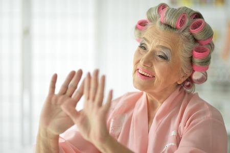 senior woman applying make up