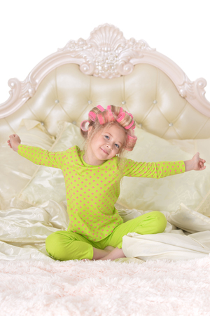 cute little girl with hair curlers