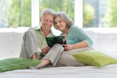 Senior couple with magazine Stock Photo