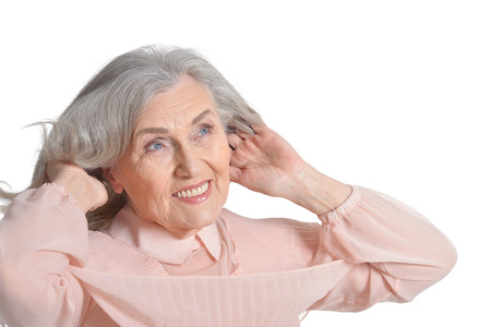 senior woman in pink blouse Stock Photo