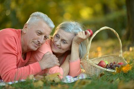 couple lying  in autumn park