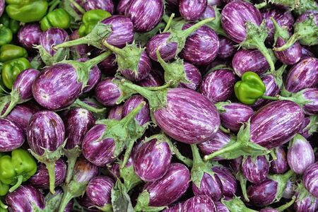 ration: A pile of ripe eggplants, close up view