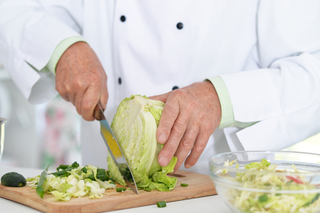 Chiefs hands cutting cabbage