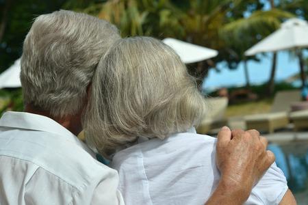 senior couple hugging outdoor Stock Photo