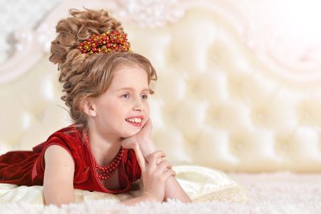 little girl in red velvet dress