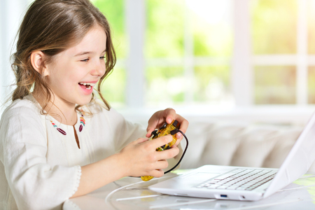 girl playing video game Stock Photo