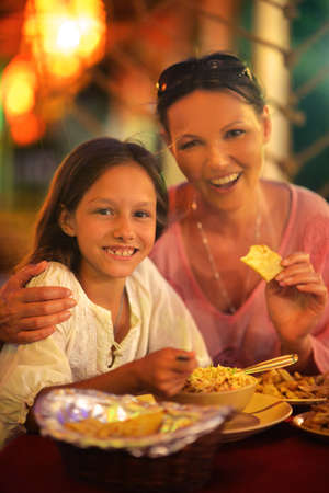 complicity: mother and daughter eating in cafe Stock Photo