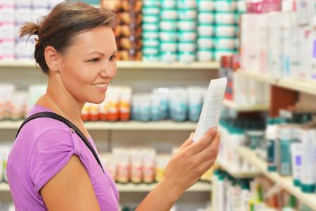 Young woman choosing cream