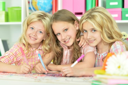 cute girls drawing with pencils Stock Photo