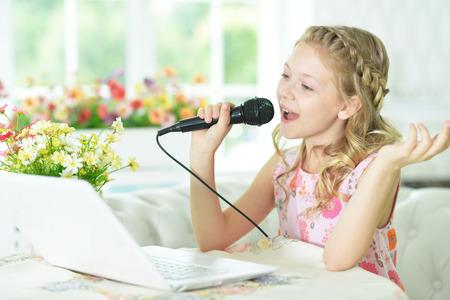 processors: girl using modern laptop