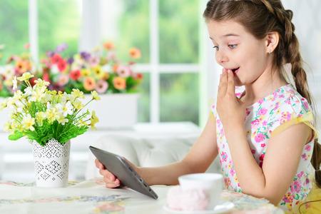 Little girl using tablet Stock Photo