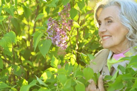 senior woman near blooming tree Stock Photo