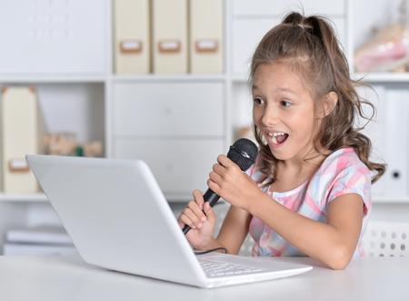 little girl singing karaoke
