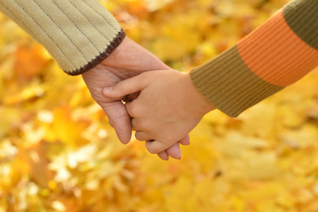 Two hands together in autumn park close up Stock Photo