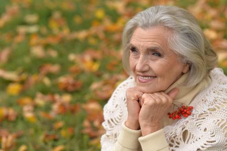 Portrait of beautiful senior woman outdoor in park Stock Photo