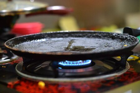 frying pan heating on gas stove close up