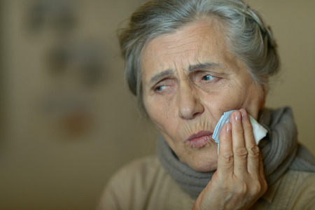 senior woman with toothache Stock Photo