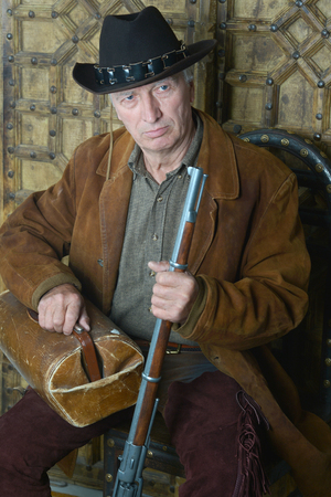 Senior male. Bandit with gun