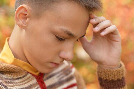 Sad boy outdoors