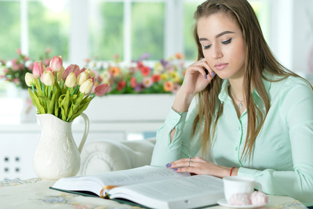 woman reading interesting book Stock Photo