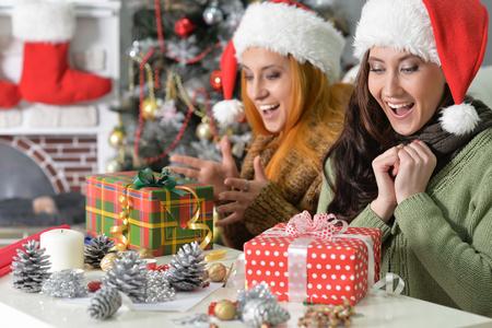 Two women celebrating Chrismas Stock Photo