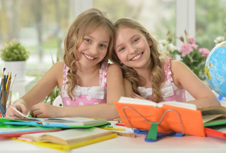 little girls doing homework