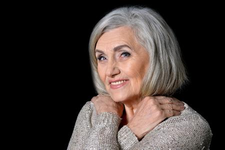 Smiling senior woman posing Stock Photo