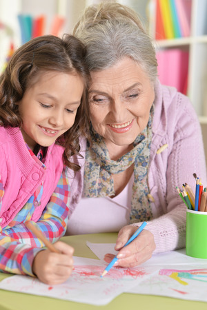 grandmother and granddaughter drawing together Stock Photo
