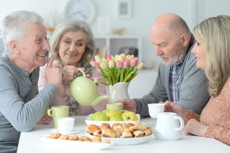 two  Senior couples drinking tea
