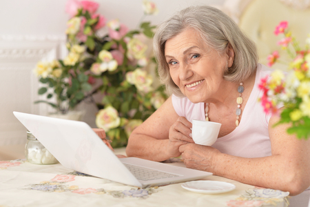 enior woman working with laptop