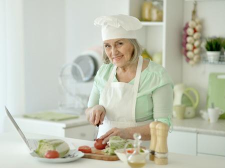 Senior chef woman portrait at kitchen Stock Photo
