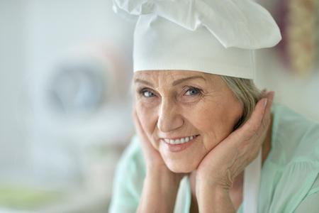 Senior chef woman happy portrait