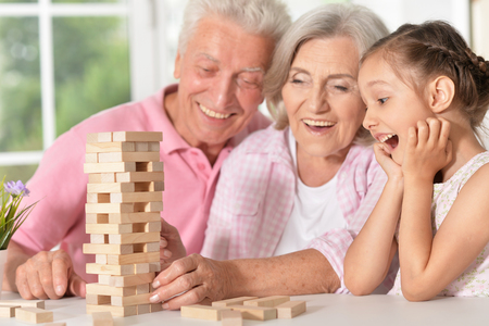 Grandparents playing with her little granddaughter