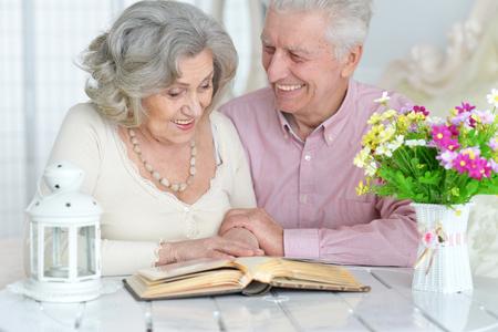 Senior couple reading magazine Stock Photo