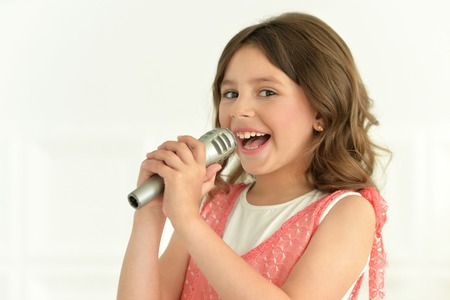 little girl singing with microphone