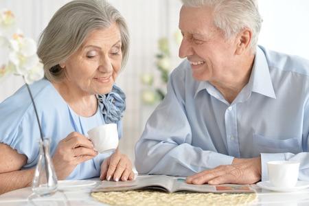 Senior couple drinking tea  and reading magazine Stock Photo