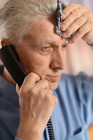 Sick old man calling doctor