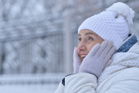 Woman in winter clothes posing look surprise