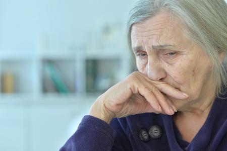 Beautiful sad elderly woman close-up 免版税图像 - 94191859