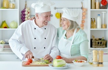 Senior couple at kitchen  cooking Stock Photo