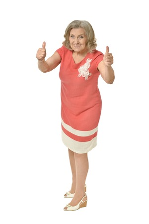 senior woman with thumbs up isolated Stock Photo