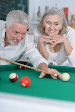 senior couple playing billiard Stock Photo