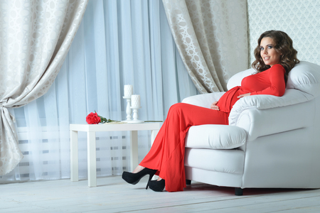 pregnant woman in red dress