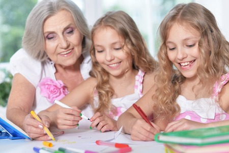 Senior woman with girls drawing Stock Photo
