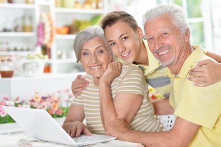 happy senior couple with grandson using  laptop Standard-Bild