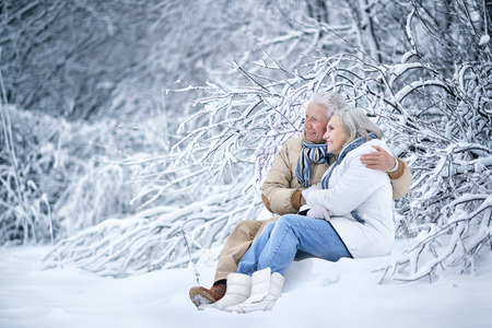 Happy senior couple at winter outdoors Banque d'images
