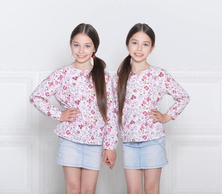 Portrait of cute little girls posing on white background 写真素材