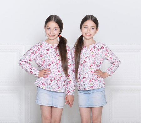 Portrait of cute little girls posing on white background Banque d'images