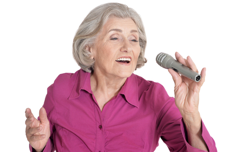 Portrait of senior singer woman on white background