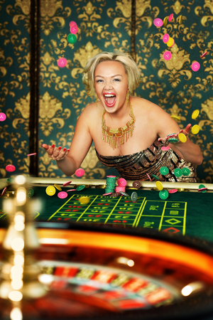 Portrait of woman playing roulette at casino